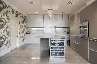 modern kitchen with a wine rack in London Albert Terrace luxury apartment