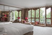 large bedroom with a series of quiant glass doors at London Albert Terrace luxury apartment