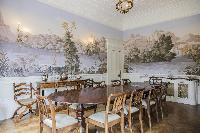 impressively wallpapered dining area in London Albert Terrace luxury apartment