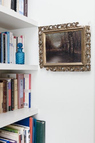 nice wall art by the bookshelf in London Clarendon Road III luxury apartment