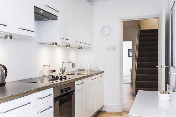 whitewashed kitchen of multilevel London Brechin Place III luxury apartment