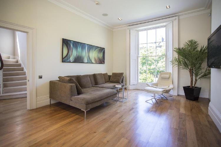natural light bathing the sitting room of London Clifton Hill luxury apartment