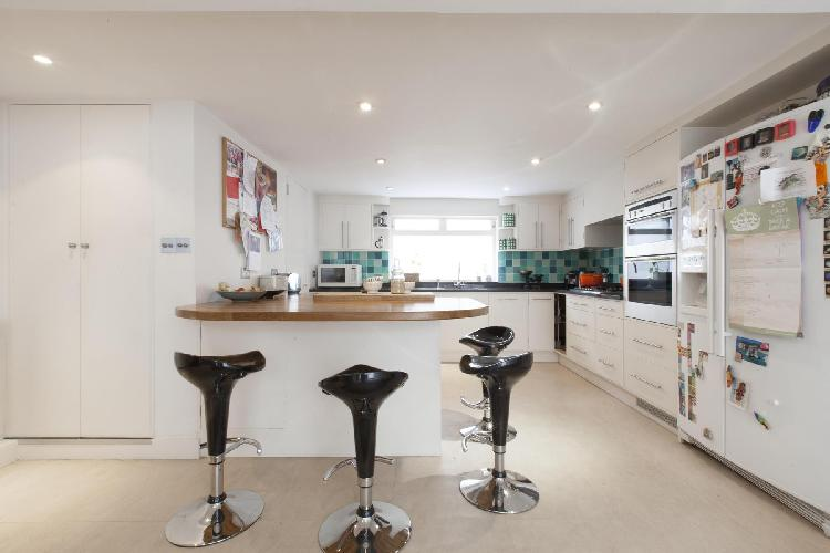 awesome kitchen and breakfast bar of London Portland Road III luxury apartment