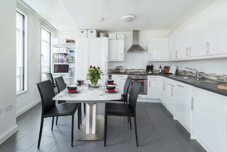 awesome dining area and kitchen of London Earnshaw Street luxury apartment