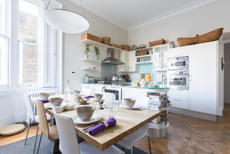 sunny and airy dining area and kitchen of London Cornwall Gardens VI luxury apartment