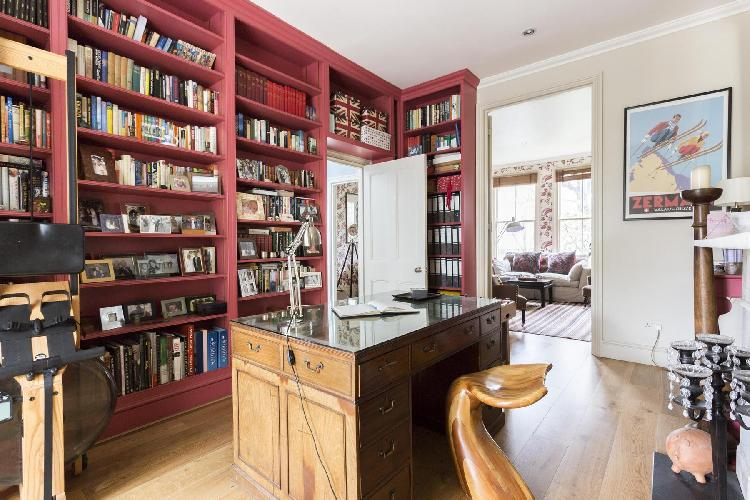 awesome wall-length bookshelf in the library of London Coningham Road luxury apartment