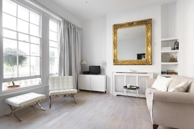 breezy and bright living room of London Alderney Street III luxury apartment