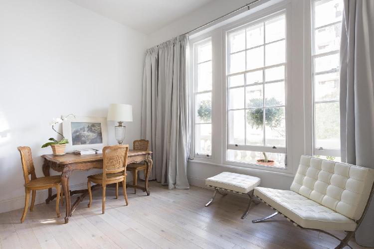 generous windows in open-plan living space of London Alderney Street III luxury apartment