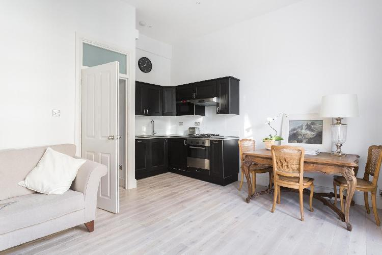 bright and breezy open-plan living room in London Alderney Street III luxury apartment