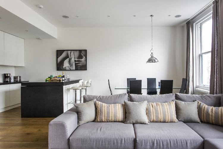 tastefully furnished open-plan living room of London Cromwell Road II luxury apartment