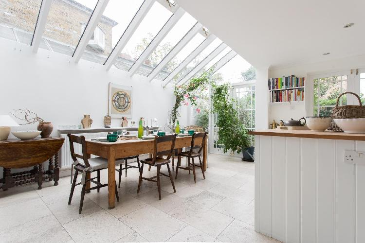 exquisite skylight-illuminated dining room of London Culford Road luxury apartment and holiday home