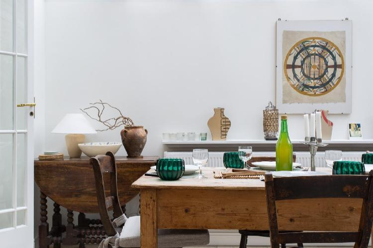 delightful dining table, chairs, and accents in London Culford Road luxury apartment