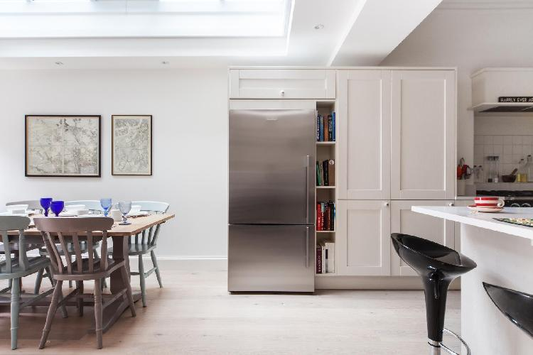 skylight-illuminated dining area of London Dunollie Place luxury apartment