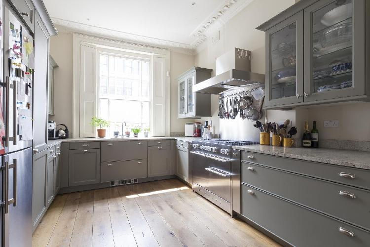 spacious kitchen with large window in London Cambridge Street V luxury apartment