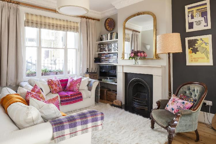 sunny and airy parlor with fireplace in London Ascham Street II luxury apartment