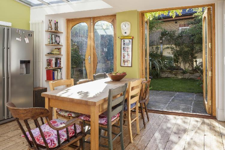 dining room under the skylight in London Ascham Street II luxury apartment