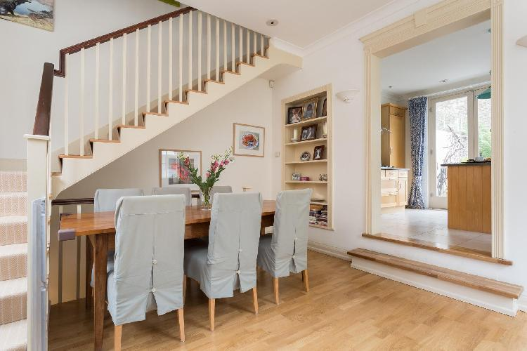 nice dining room in multilevel charming and cheery London Cale Street luxury apartment