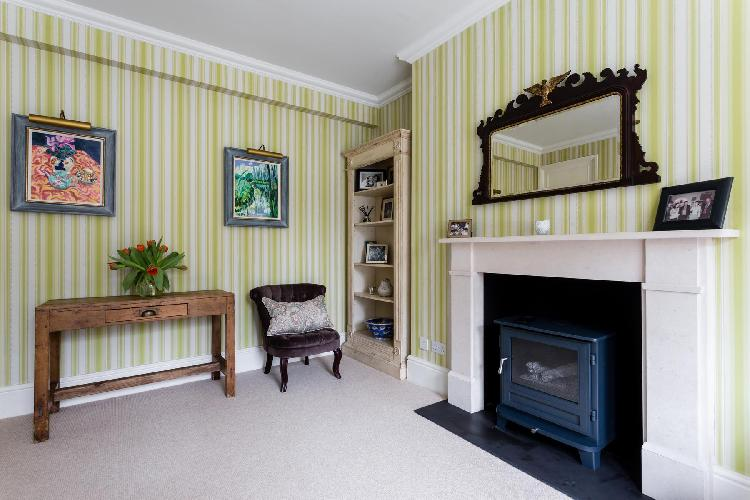 awesome living room with fireplace in London Elm Park Gardens XI luxury apartment