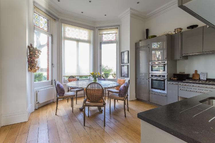 chic and charming dining area of London Eton Avenue III luxury apartment