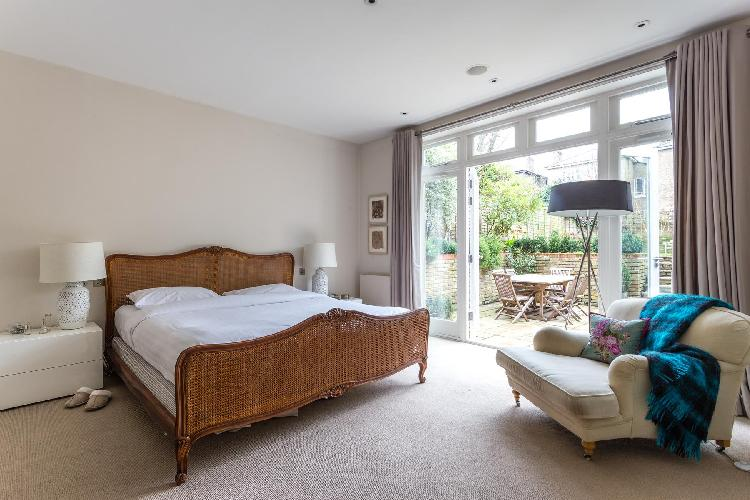 awesome bedroom with a balcony at London Eton Avenue III luxury apartment
