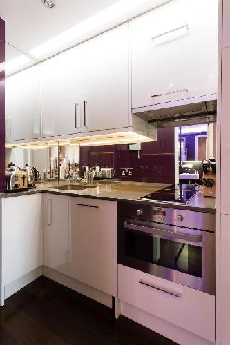 cool modern kitchen of London Duke of York Street luxury apartment