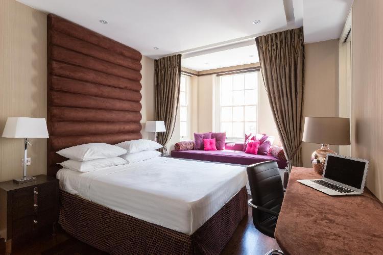 lovely bedroom of London Duke of York Street luxury apartment