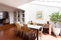 bright and breezy dining area under the skylight of London Afghan Road luxury apartment