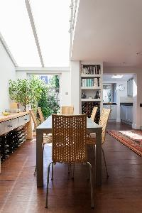 long skylight illuminating the dining area of London Afghan Road luxury apartment