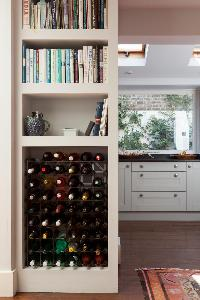 cabinet with a bookshelf and a wine rack in London Afghan Road luxury apartment