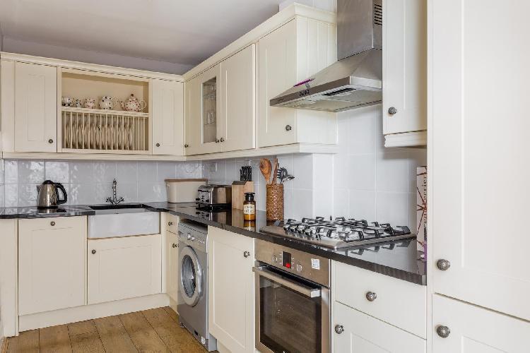 cool modern kitchen of London Radley Mews luxury apartment
