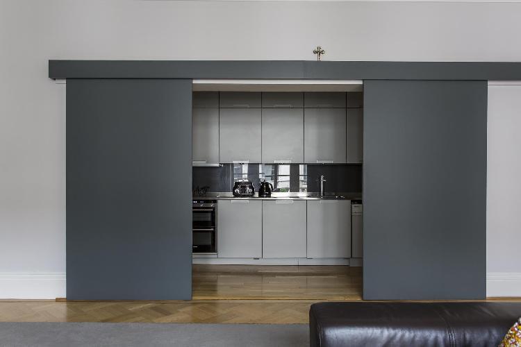 sleek compact kitchen in London De Vere Gardens III luxury apartment