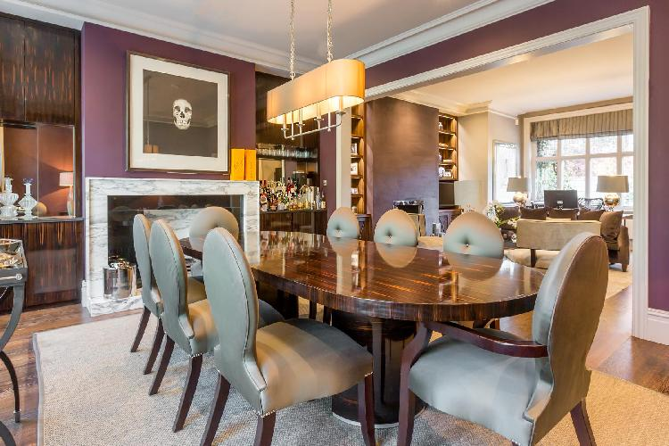 polished wooden dining table in London Addison Road III luxury apartment