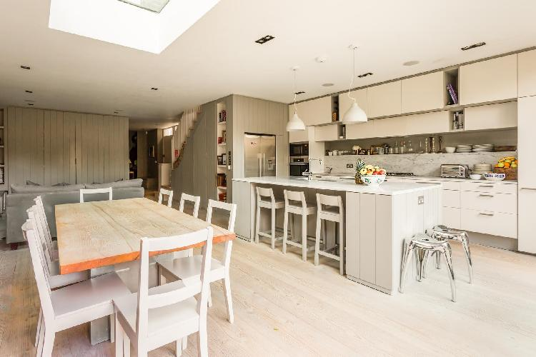skylight-illuminated kitchen and dining room London Caithness Road V luxury apartment and vacation r
