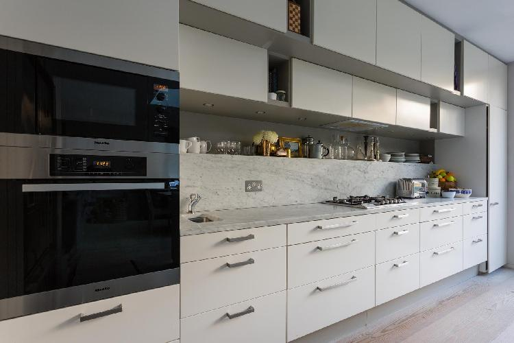 modern kitchen appliances and cabinets of London Caithness Road V luxury apartment
