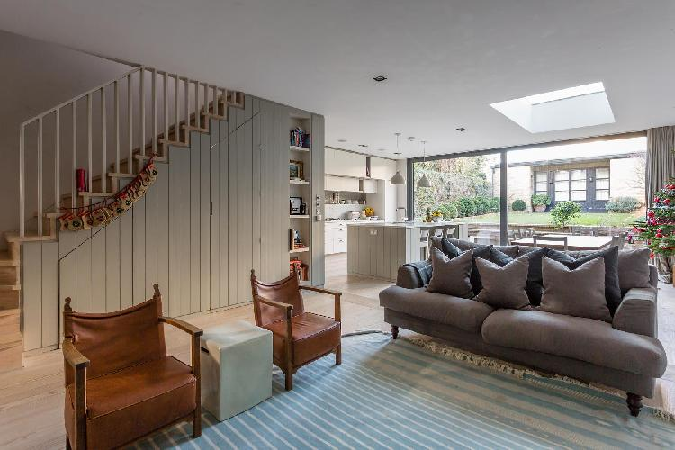 cheery and chic sitting room of multilevel London Caithness Road V luxury apartment