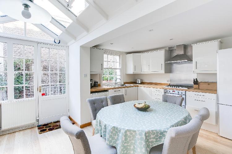 skylight illuminating the large kitchen in cheery and chic London Cadogan Street III luxury apartmen