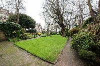 lush greenery surrounding London Airlie Gardens IV luxury apartment