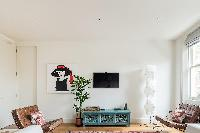 TV room with modern wall art in London Airlie Gardens IV luxury apartment