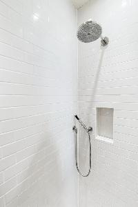 rain-shower fixture of bathroom of London Airlie Gardens IV luxury apartment