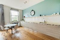 dining area and kitchen of London Airlie Gardens IV luxury apartment