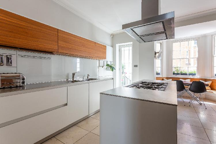 modern kitchen appliances and cabinets in London Cadogan Place II luxury apartment