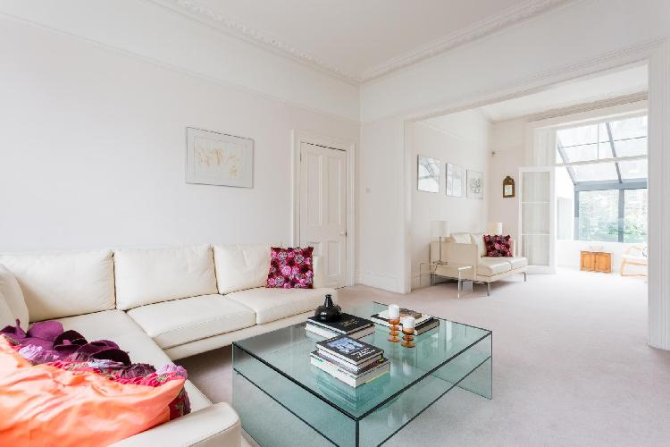 breezy and bright living room of London Fitzroy Road luxury apartment
