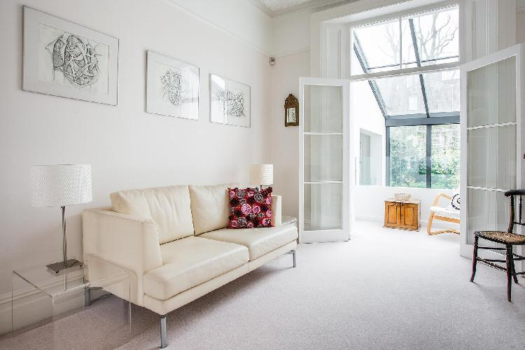 bright and breezy living room of London Fitzroy Road luxury apartment