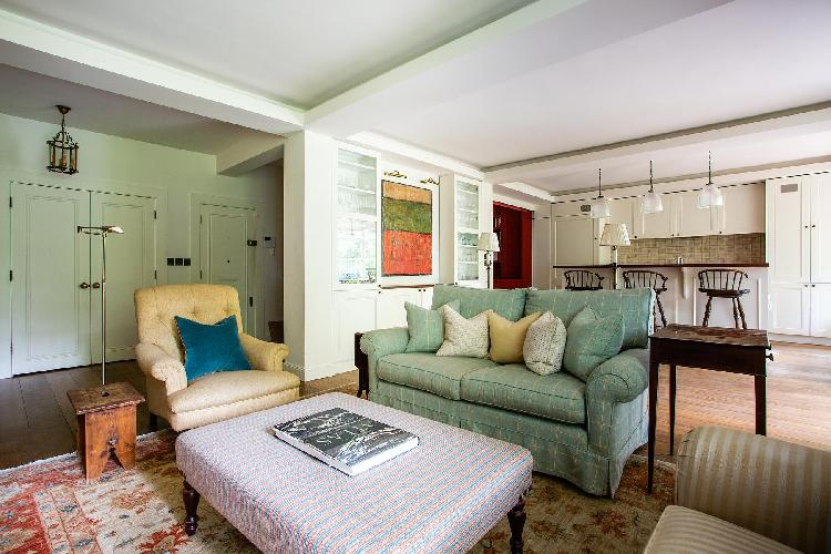 elegant couches in the sitting room of London Airlie Gardens V luxury apartment