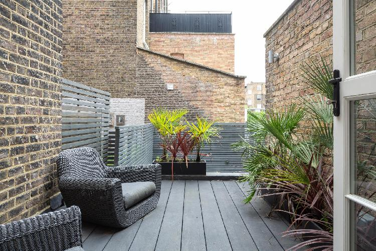 beautiful brick-lined, furnished deck of London Chalcot Road IV luxury apartment
