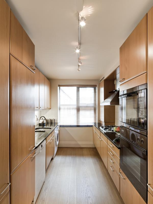 modern kitchen appliances and cabinets in London Brick Street luxury apartment