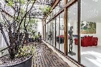 relaxing courtyard with a wooden landscape garden in a 2-bedroom loft Paris luxury apartment