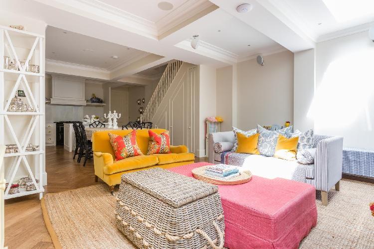 fancy open plan living room of multilevel London Brunswick Gardens II luxury apartment