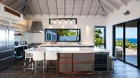 cool modern kitchen of Saint Barth Villa Jocapana luxury holiday home, vacation rental