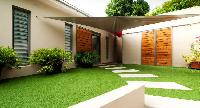 neat lawn of Saint Barth Villa Cumulus luxury holiday home, vacation rental